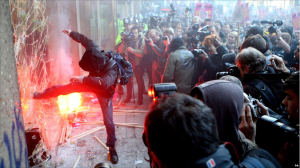 "Window smashed during 2010 student protests in London. Image ""courtesy"" of BBC."