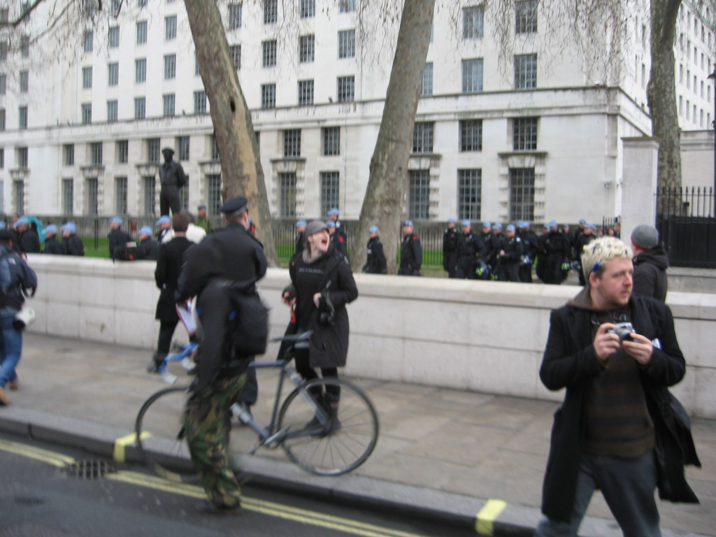 Riot police reveal themselves