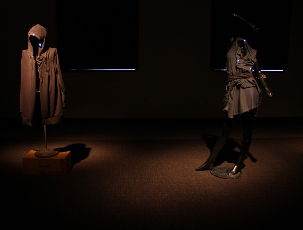 Dark cloaks with small blue lights and electronics woven in.